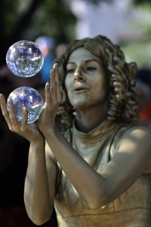 TORONTO-AUGUST 25: Dawns Dream a street performer performing with a crystal ball during the Buskerfest Festival on August 25, 2012 in Toronto, Canada.