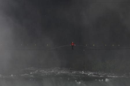 daredevil: NIAGARA FALLS -JUNE 15: Nik Wallanda just after he started his walk from the USA side while crossing the Niagara Falls on a tightrope on June 15 2012 in Niagara Falls, Canada.