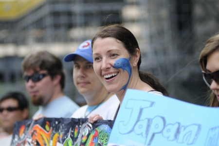 TORONTO-AUGUST 31: Happy protesters during a rally to protest the start of the annual dolphin hunt at Taiji,Japan on August 31, 2012 in Toronto, Canada.
