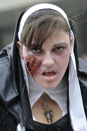 TORONTO-OCTOBER 20: A Participant dresses as a nun during the Halloween parade on October 20, 2012 in Toronto, Canada.