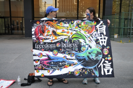 TORONTO-AUGUST 31: Two protesters sharing a laugh during a rally to protest the start of the annual dolphin hunt at Taiji,Japan on August 31, 2012 in Toronto, Canada. Redakční