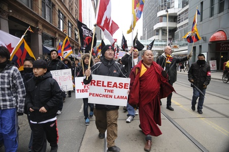 TORONTO - MARCH 10: Buddhist Monks marching in a rally organized to protest against the Chinese occupation of Tibet on March 10 2009 in Toronto, Canada.