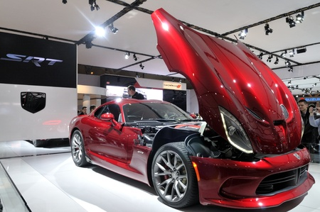 TORONTO-FEBRUARY 22: A red Chrysler Viper with its bonnet open on display during the 40th International Auto Show on February 22, 2013 in Toronto, Canada.
