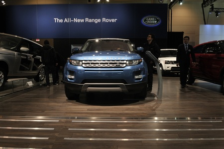 TORONTO-FEBRUARY 22: Customers checking out a blue Land Rover during the 40th International Auto Show on February 22, 2013 in Toronto, Canada.