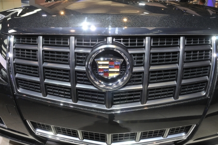 bonnet up: TORONTO-FEBRUARY 22: Close up of a Cadillac XTS Sedan bonnet during the 40th International Auto Show on February 22, 2013 in Toronto, Canada. Editorial