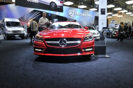TORONTO-FEBRUARY 22: A red Mercedes-Benz on display during the 40th International Auto Show on February 22, 2013 in Toronto, Canada.
