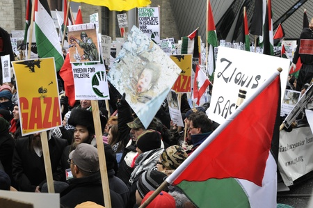 TORONTO - JANUARY 10: Demonstrators marching in a rally organized to condemn the Israel occupation on Gaza on January 10 2009 in Toronto, Canada.