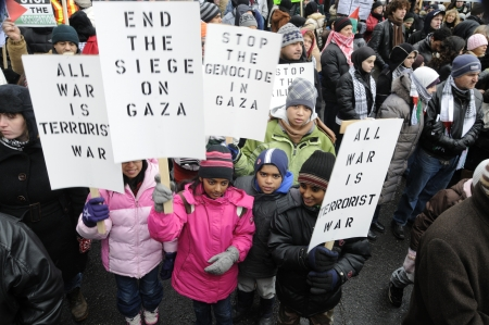 TORONTO - JANUARY 10: A small group of unidentified kids holding banners and placards during a rally to condemn the Israel occupation on Gaza on January 10 2009 in Toronto, Canada.
