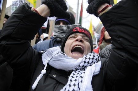 middle east crisis: TORONTO - JANUARY 10: An angry old woman yelling during a rally to condemn the Israel occupation on Gaza on January 10 2009 in Toronto, Canada.