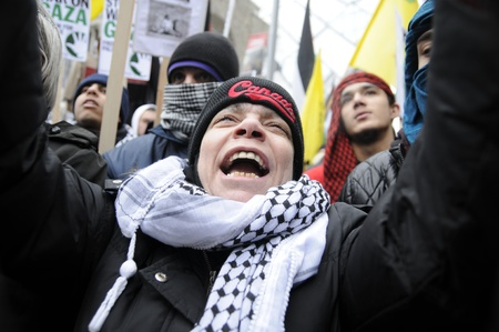 TORONTO - JANUARY 10: An agitated old woman yelling during a rally to condemn the Israel occupation on Gaza on January 10 2009 in Toronto, Canada.