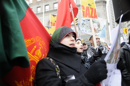 TORONTO - JANUARY 10: An Arab woman chanting slogans while listening to the speakers during a rally to condemn the Israel occupation on Gaza on January 10 2009 in Toronto, Canada.