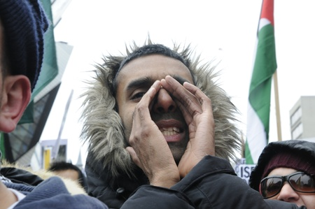 rally finger: TORONTO - JANUARY 10: A male Arab protestor shouting slogans during a rally to condemn the Israel occupation on Gaza on January 10 2009 in Toronto, Canada.