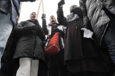 chanting: TORONTO - JANUARY 10: Arab teens chanting slogans against Israeli atrocities during a rally to condemn the Israel occupation on Gaza on January 10 2009 in Toronto, Canada. Editorial