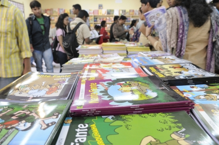 english famous: KOLKATA- FEBRUARY 4: People crowd in at the book stall carrying english translations of famous bengali cartoon characters during the 2011 Kolkata Book Fair in Kolkata, India on February 4, 2011. Editorial