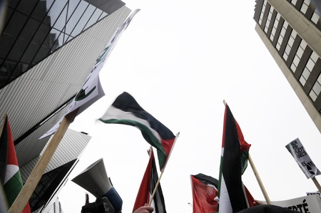 middle east crisis: TORONTO - JANUARY 10: Palestine flags flying during a rally to condemn the Israel occupation on Gaza on January 10 2009 in Toronto, Canada. Editorial