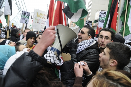 middle east crisis: TORONTO - JANUARY 10: Arab youths chanting slogans with loudspeakers during a rally to condemn the Israel occupation on Gaza on January 10 2009 in Toronto, Canada.