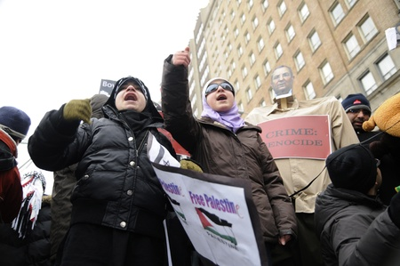 chanting: TORONTO - JANUARY 10: Protestors chanting slogans during a rally to condemn the Israel occupation on Gaza on January 10 2009 in Toronto, Canada.