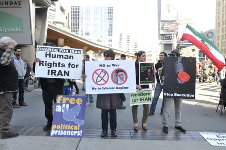 anti war: TORONTO - MARCH 11: Anti war protestors asking for freedom and liberal democracy in Iran during a protest on March 11 2012 in Toronto, Canada. Editorial