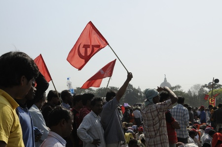 hammer and sickle: KOLKATA- FEBRUARY 13: The communist symbol of hammer & sickle flying during a political rally in Kolkata, India on February 13, 2011.