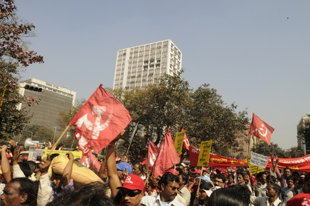 KOLKATA- FEBRUARY 13: Communist supporters yell and shout during a political rally in Kolkata, India on February 13, 2011.