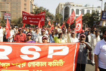 KOLKATA- FEBRUARY 13: Followers of the Revolutionary Socialist Party a coalition partner in the West Bengal government-particip ating in a political rally in Kolkata, India on February 13, 2011. Editorial