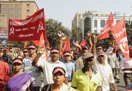 political rally: KOLKATA- FEBRUARY 13: Pro Government supporters chant slogans during a political rally in Kolkata, India on February 13, 2011.