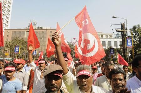 KOLKATA- FEBRUARY 13: Agitated supporters chant slogans during a political rally in Kolkata, India on February 13, 2011.
