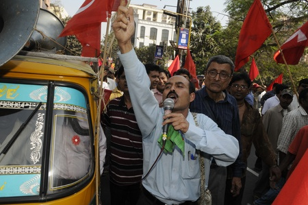 KOLKATA- FEBRUARY 13: A group of supporters chant slogans during a political rally in Kolkata, India on February 13, 2011. Editorial