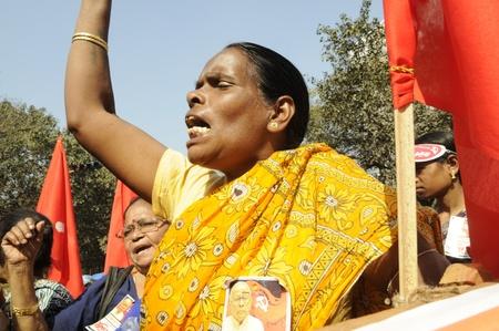 political rally: KOLKATA- FEBRUARY 13: An angry woman supporter during a political rally in Kolkata, India on February 13, 2011.