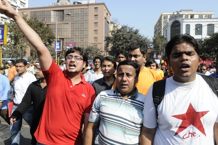 KOLKATA- FEBRUARY 13: The members of the youth organization of the ruling party in West Bengal participate in a political rally in Kolkata, India on February 13, 2011.