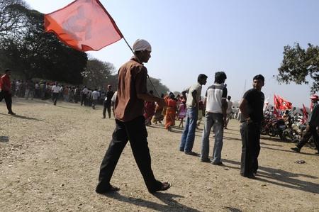 political rally: KOLKATA- FEBRUARY 13: A man walks with a CPI(M) flag during a political rally in Kolkata, India on February 13, 2011. Editorial