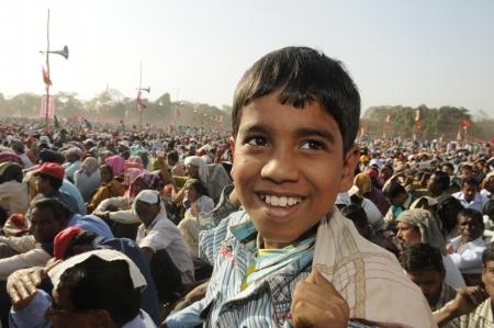 merchant: KOLKATA- FEBRUARY 13: A small kid sharing a laugh during a political rally in Kolkata, India on February 13, 2011.