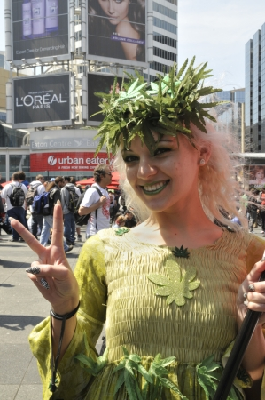 TORONTO - APRIL 20: A marijuana legalization supporter showing a victory sign during the annual marijuana 420 event at Yonge & Dundas Square on April 20 2012 in Toronto, Canada.