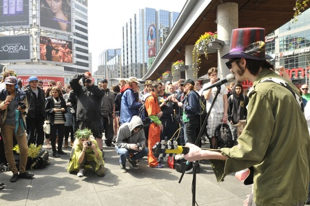 TORONTO - APRIL 20: Live band performing and entertaining crows during the annual marijuana 420 event at Yonge & Dundas Square on April 20 2012 in Toronto, Canada. Editorial