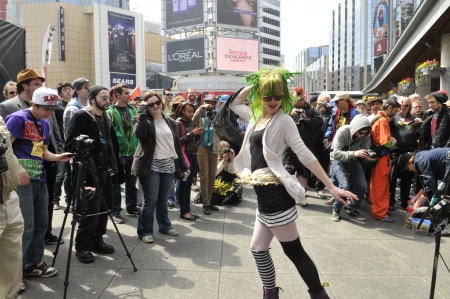 TORONTO - APRIL 20: Supporters of legalization of marijuana having fun during the annual marijuana 420 event at Yonge & Dundas Square on April 20 2012 in Toronto, Canada.