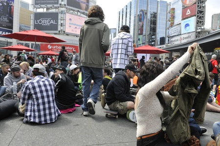 TORONTO - APRIL 20: Marijuana legalization supporters enjoying themselves during the annual marijuana 420 event at Yonge & Dundas Square on April 20 2012 in Toronto, Canada.