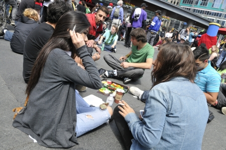 TORONTO - APRIL 20: Pro marijuana activists smoking pots during the annual marijuana 420 event at Yonge & Dundas Square on April 20 2012 in Toronto, Canada. Editorial