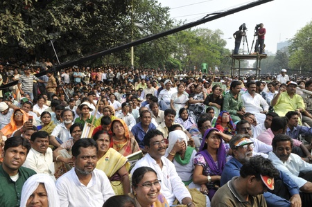 KOLKATA - FEBRUARY 20: Audiences listening to the speeches during a rally of All India Trinamool Congress ,organized to kick the 2011 election champagne, in Kolkata, India on February 20, 2011.