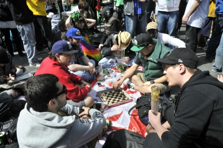 TORONTO - APRIL 20: Group of marijuana activists hanging out and playing chess during the annual marijuana 420 event at Yonge & Dundas Square on April 20 2012 in Toronto, Canada.