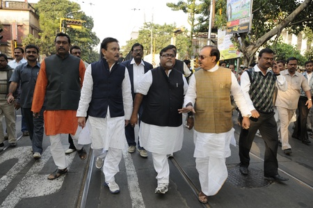 KOLKATA- DECEMBER 20: Prominent Trinamool Congress leaders walking during a rally with supporters corpse in Kolkata, India on December 20, 2010.