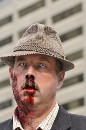 TORONTO-OCTOBER 20: A man with heavy Zombie make up during the Halloween parade on October 20, 2012 in Toronto, Canada.