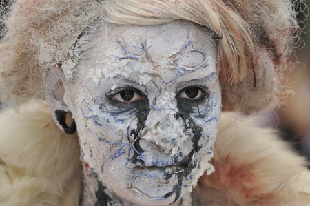 TORONTO-OCTOBER 20: An unidentified woman with witch make up during the Halloween parade on October 20, 2012 in Toronto, Canada.