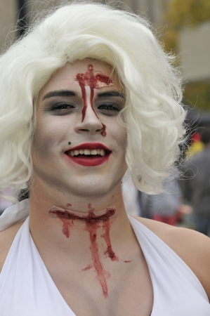 TORONTO-OCTOBER 20: A participant dressed as a transgender during the Halloween parade on October 20, 2012 in Toronto, Canada.