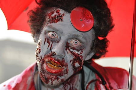 TORONTO-OCTOBER 20: A man with fake blood stained face during the Halloween parade on October 20, 2012 in Toronto, Canada.