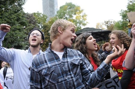 occupy wall street: TORONTO - OCTOBER 15: Protestors chanting slogans and simultaneously dancing with live music during the Occupy Toronto Movement on October 15, 2011 in Toronto, Canada. Editorial