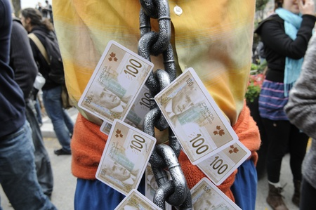 protestor: TORONTO - OCTOBER 17: A protestor wearing a metal chain which is changed with $ 100 bills during the Occupy Toronto Movement on October 17, 2011 in Toronto, Canada.