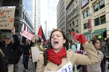 protestor: TORONTO - OCTOBER 17: Angry protestor chanting slogans while participating in a rally during the Occupy Toronto Movement on October 17, 2011 in Toronto, Canada. Editorial