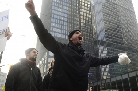 occupy movement: TORONTO - NOVEMBER 24: An angry occupy Toronto protester chanting slogans in downtown Toronto during a occupy movement rally on November 24, 2011 in Toronto, Canada.