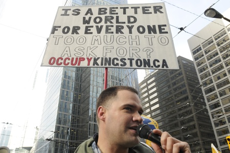 TORONTO - NOVEMBER 24: An Occupy Toronto protester giving speech in front of the Toronto Stock Exchange during a rally on November 24, 2011 in Toronto, Canada.