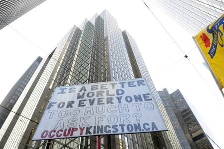 TORONTO - NOVEMBER 24: Occupy movement messages taking control over the financial district of Downtown Toronto during a rally on November 24, 2011 in Toronto, Canada.